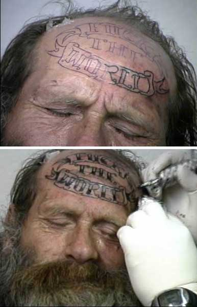 fuck the world forehead tattoo